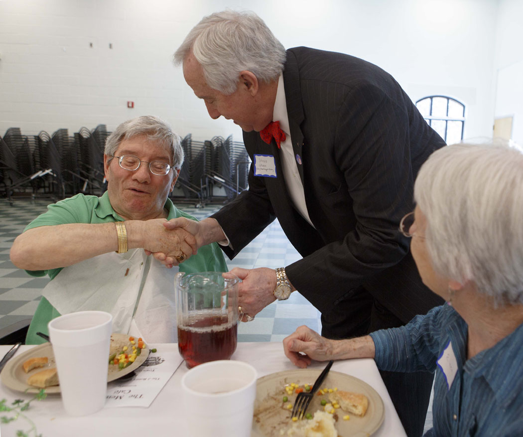 At Memory CafeDances: Sandy Kirkland with wellness assistant Jackie Green of Woodland Terrace; Duke Hat: Gary Gray, wife Chri; others at table: Rich and Pat Walters;Wheelchair: Benard Schneider, wife Eileen; hora stripes: Denise Doyle; blond: Sandra Heighinton Cary Rotary