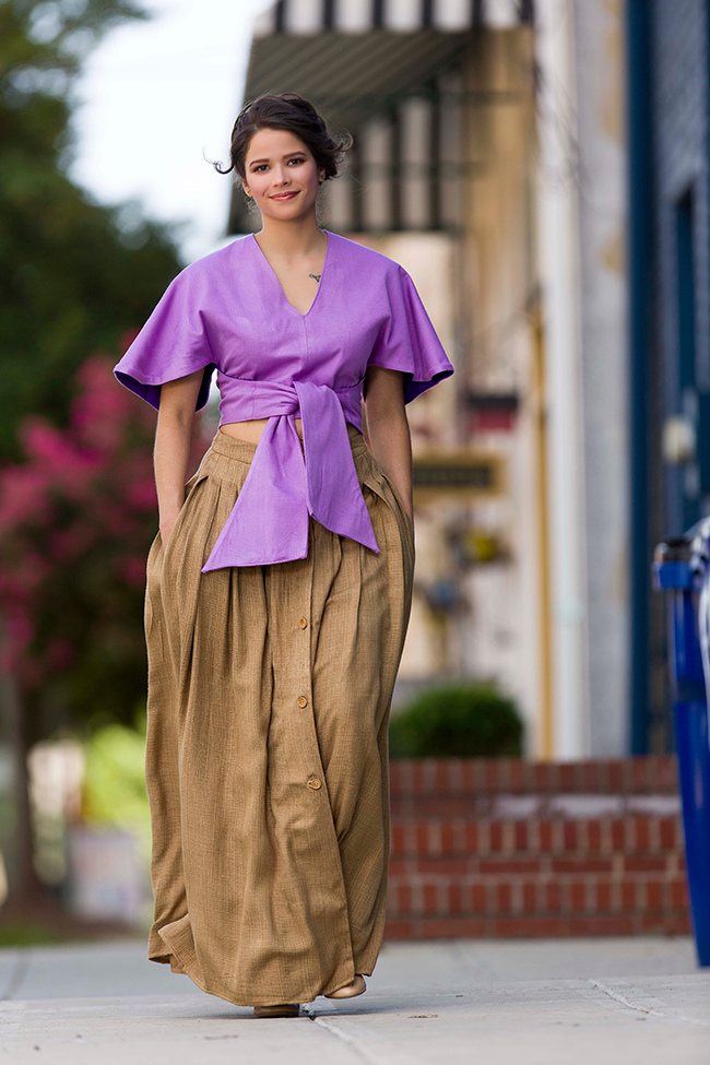 Inspired by the traditional wear of her fair-trade partners in Guatemala, designer Katina Gad offers up this fully-lined skirt with pockets, naturally dyed with coconut and coffee, and boasting hand-carved wooden buttons. The top is made of cotton grown, spun and woven in Guatemala, and dyed using basil.