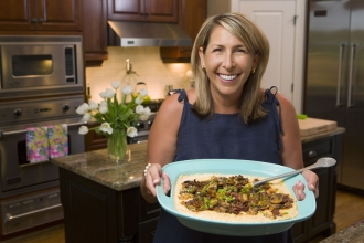 Real estate agent Julie Woodcock visits Takeout Market regularly, especially when her schedule gets hectic. Her family likes Southern-influenced meals like this shrimp and grits entree.