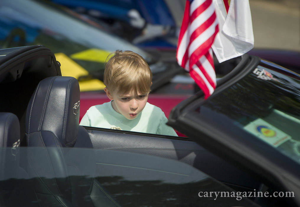 His collection of Hot Wheels at home is cool, but this hot rod rules! At least that's what the expression of 4-year-old Griffin Efird says, when checking out a Corvette convertible during Cary's fourth annual Wheels on Academy car show, 2014.