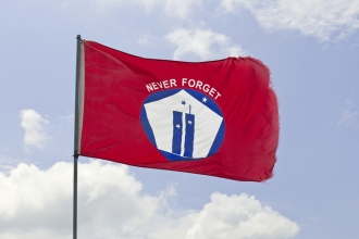 """A """"Never Forget"""" flag flies over the Flight 93 National Memorial in Pennsylvania."""