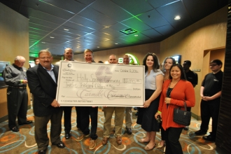 As a show of community support, Ovation Cinema Grill 9 donated the proceeds from its $3 movie preview days, totaling $12,000, to local schools and nonprofits.