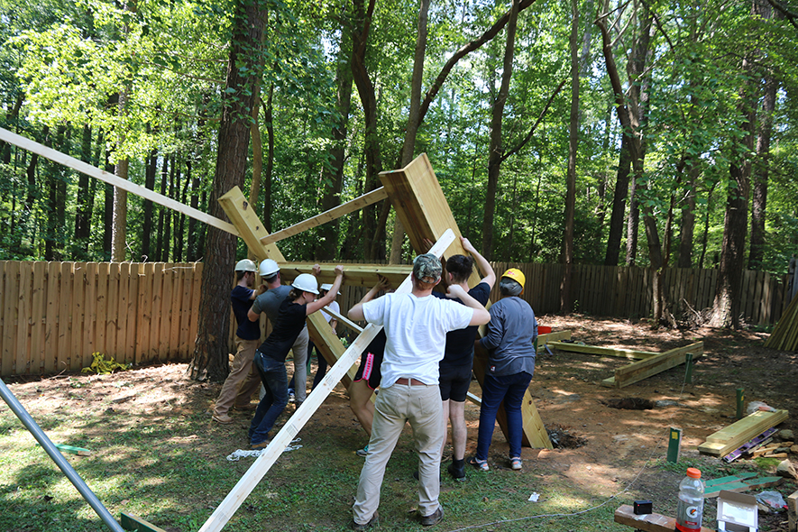 AIAS FBD team members construct an adult-sized play structure for residents of the Living With Autism group home.