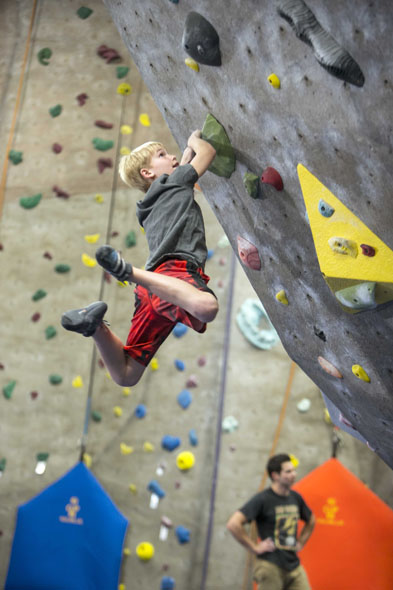 Cary 11-year-old Josh Gerhardt, a qualifier for the U.S. National Team, hones his boulder climbing skills while practicing with Team TRC.