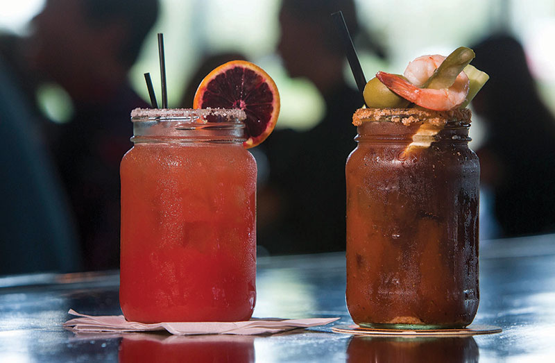 Blood Orange Margarita, left, and the Loaded Bloody Mary from The Mason Jar Tavern.