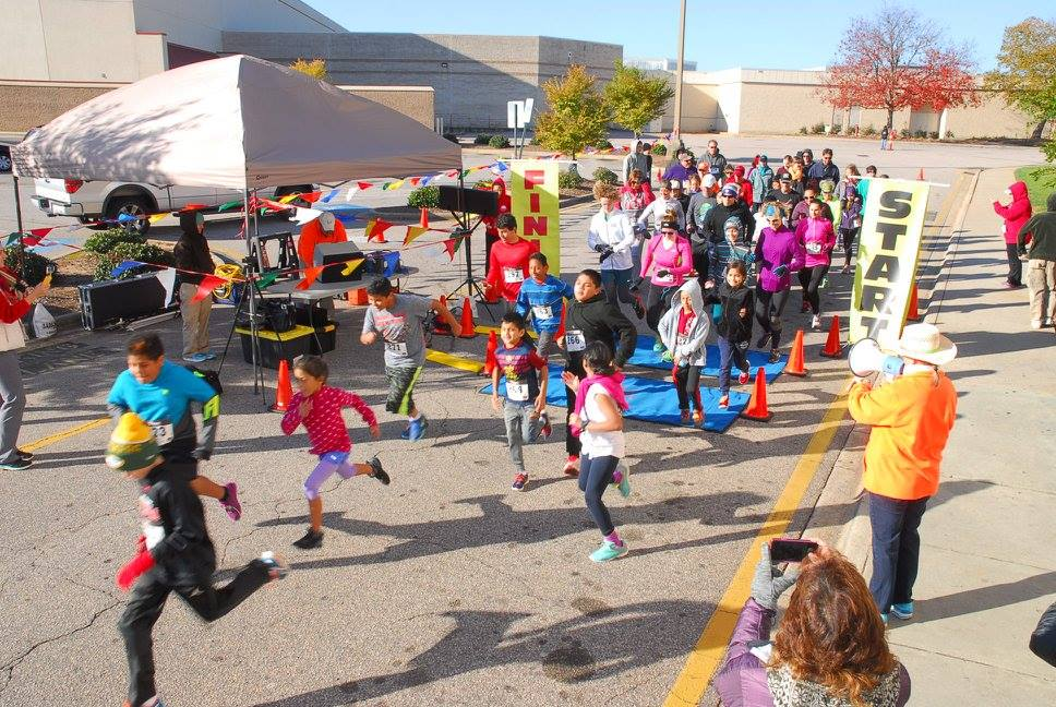 Energetic children are first off the starting line at the Cozy Toes Fun Run.