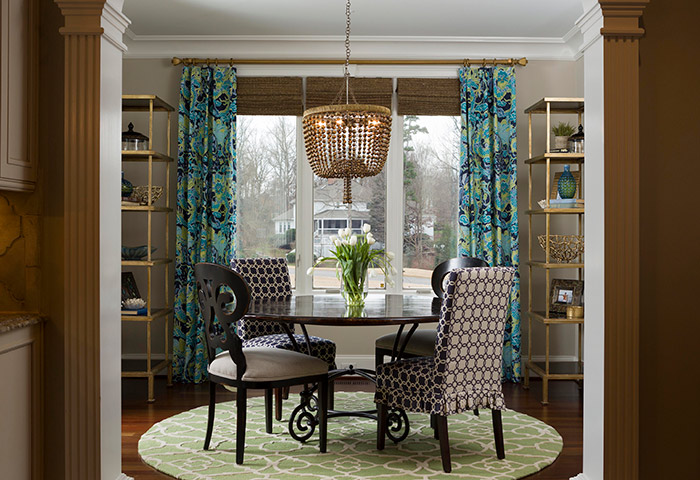 While the home's kitchen features a neutral color scheme, the adjoining breakfast room allows Cooling to share her love of color and pattern. In for 2017, note local designers Vicky Serany and Lauren Burns, are warm metals and jewel tones. Pillows and paint can offer the biggest bang for your buck, Burns says, as an easy, inexpensive way to add fresh colors and patterns.