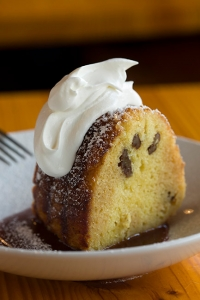 Caribbean rum cake with caramel sauce and whipped cream