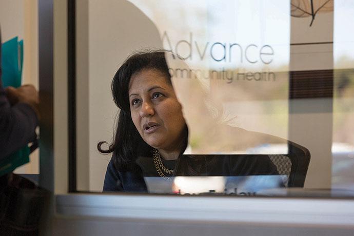 Medical receptionist Days Nunez speaks to a client.