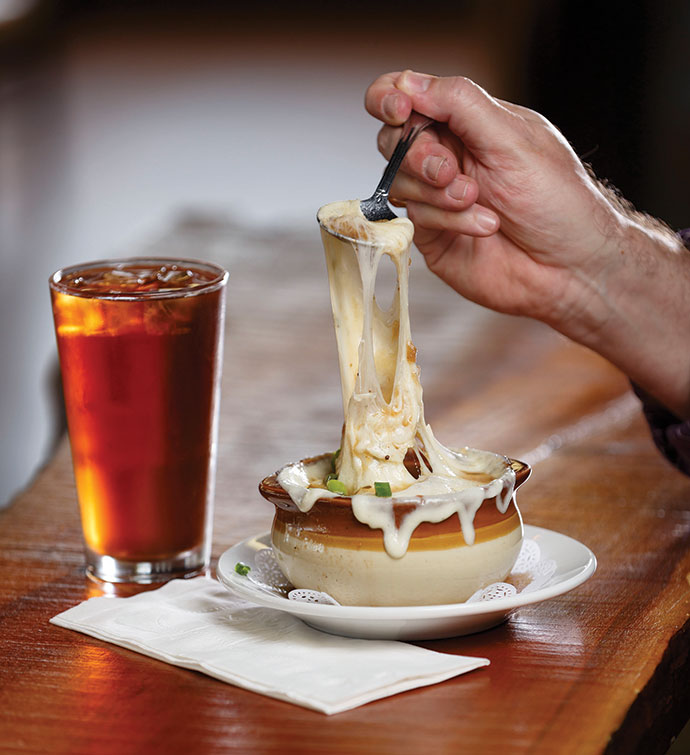 Cheesy baked French onion soup at the Crosstown Pub & Grill is a popular menu item.