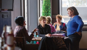 Crosstown owner Sheila Ryan chats with customers at the Crosstown Pub.