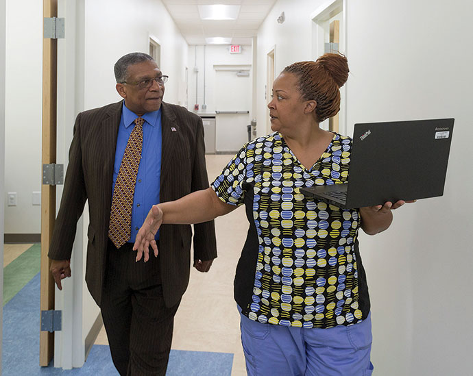 Above: Medical assistant Tawana Daniel speaks with Howard Manning, executive director of Dorcas Ministries.