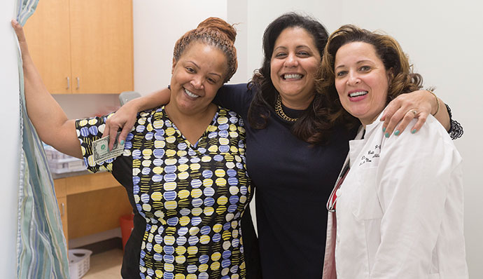 Medical assistant Tawana Daniel, left, receptionist Days Nunez, center, and family nurse practitioner Datanya Betts.