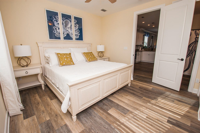 "The beachy decor, like the octopus print above the bed, left, ""wouldn't go in my house in Cary,"" confessed Kim Hall, but she loves the look for the family's island home."