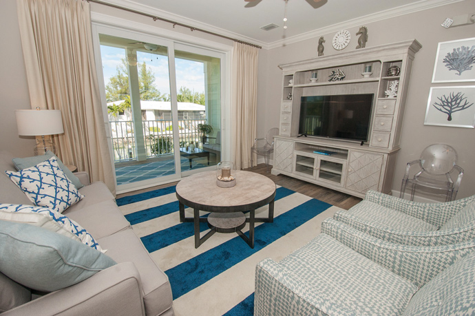 Owner Kim Hall says the living room is her favorite space in her Marathon, Fla., home. Neutral colors are accented with pops of blue and ocean-themed accessories to create a relaxing, coastal atmosphere.
