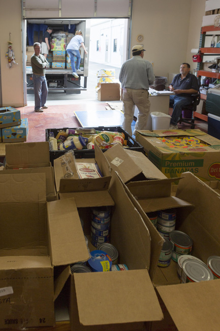 A truckload of donated food awaits volunteers who will stock shelves, refrigerators and freezers.