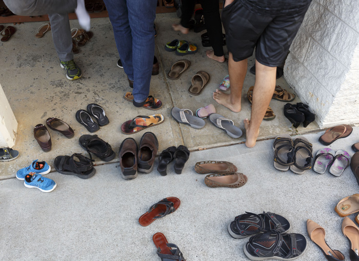 Shoes are removed at the gates of the temple compound, as the courtyard and the temple itself are sacred spaces. Followers of the Hindu religion walk around the temple in a clockwise path in order to tap into the sacred energy of the cosmos.