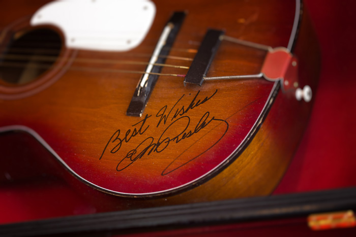 "An acoustic guitar autographed by the late Elvis Presley hangs at the Rock Harbor Grill. Owner David Vance calls it ""the best gift I've ever received."""