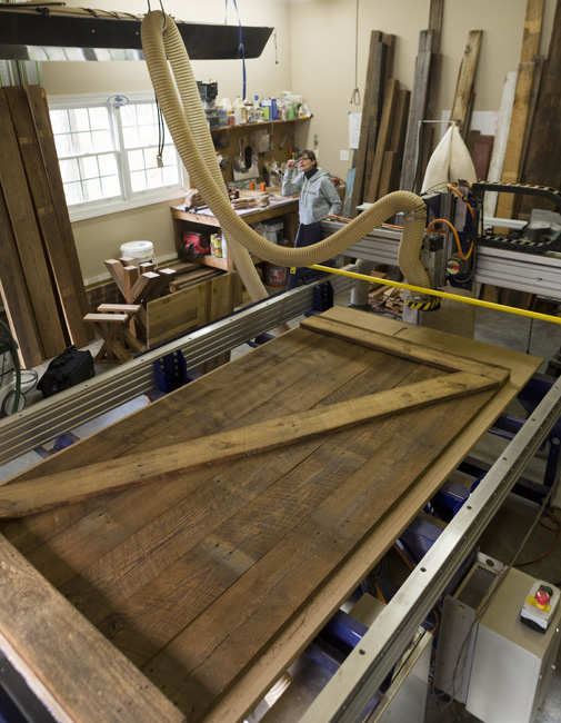 The new barn door, made of old wood, takes shape in Thompson's Fuquay-Varina workshop.