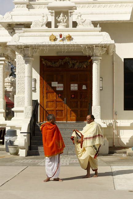 Rajagopala Kanduri, left, and Varadarajan Golluru are two of the six priests who perform daily devotions at the Cary temple. During Ugadi, visitors pay their respects and leave food and other offerings inside the temple.