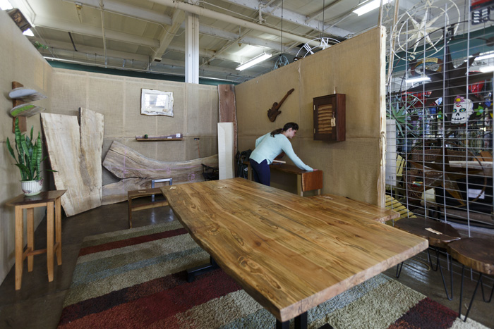 Live Edge Wood Design's Liz ___ showscases furniture at the NC State Fairgrounds booth.