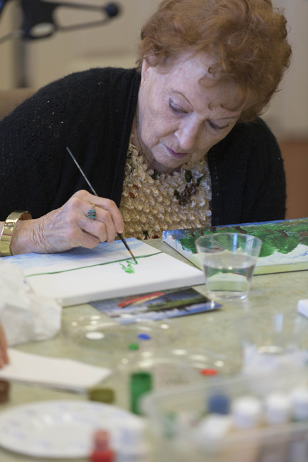"Joy Scott works on her latest landscape at a weekly art class for assisted living residents at Waltonwood in Cary. For seniors, ""Art helps hand-eye coordination, and keeps the mind going through that thought process of creativity,"" says Chester Williams, a retired art professor who recently added this class after teaching independent-living Waltonwood residents for more than four years."