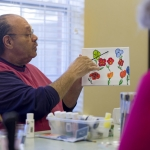 Artist and retired professor Chester Williams leads classes for seniors, at Waltonwood in Cary.