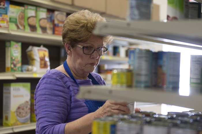 Western Wake Crisis Ministry volunteer Reni Robbins stocks dry goods at the Apex warehouse.