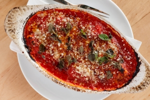 Oregano dots the top of the ricotta gnocchi appetizer.
