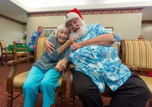 Brookdale MacArthur Park resident Casey Griffen, 87, tugs on Santa's beard.