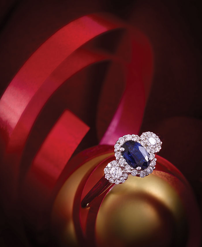 This three-stone ring with a blue sapphire and diamonds from Johnson Jewelers is set in 14K white gold.
