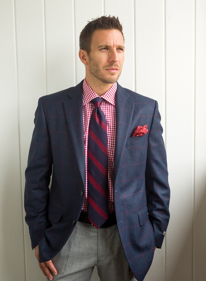 Red and white gingham shirt, $155; Pants, $175; Tie, $115; Polka dot pocket square, $59.50; Blue jacket with red windowpane, $795; From Ashworth's Clothing