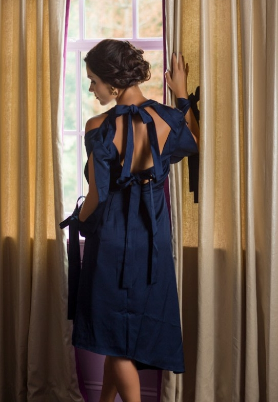 Navy tie-back dress, $198 Gold twist earrings, $32 From The Art of Style