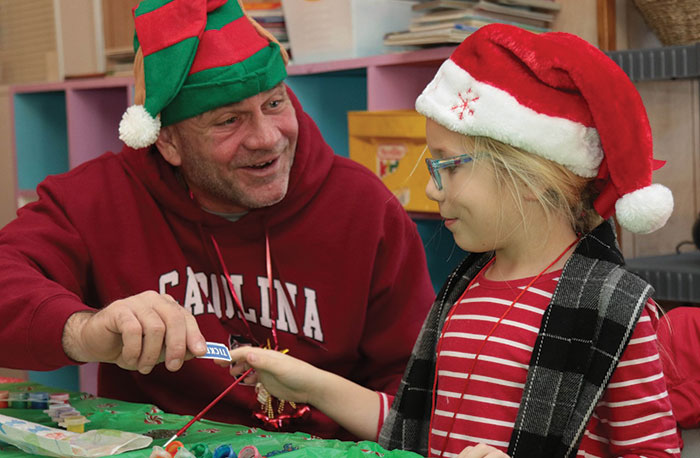 Supper with Santa's elves and a holiday cookie contest are fun for the kids.