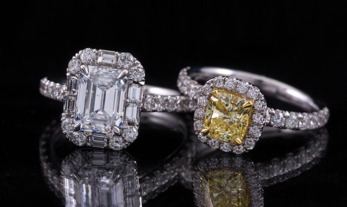 These rings from Diamonds Direct are examples of the popular halo style. The emerald-cut diamond engagement ring, left, has a halo of round brilliant- and baguette-cut diamonds. The yellow cushion-cut diamond ring, right, has a halo of round brilliant-cut diamonds.