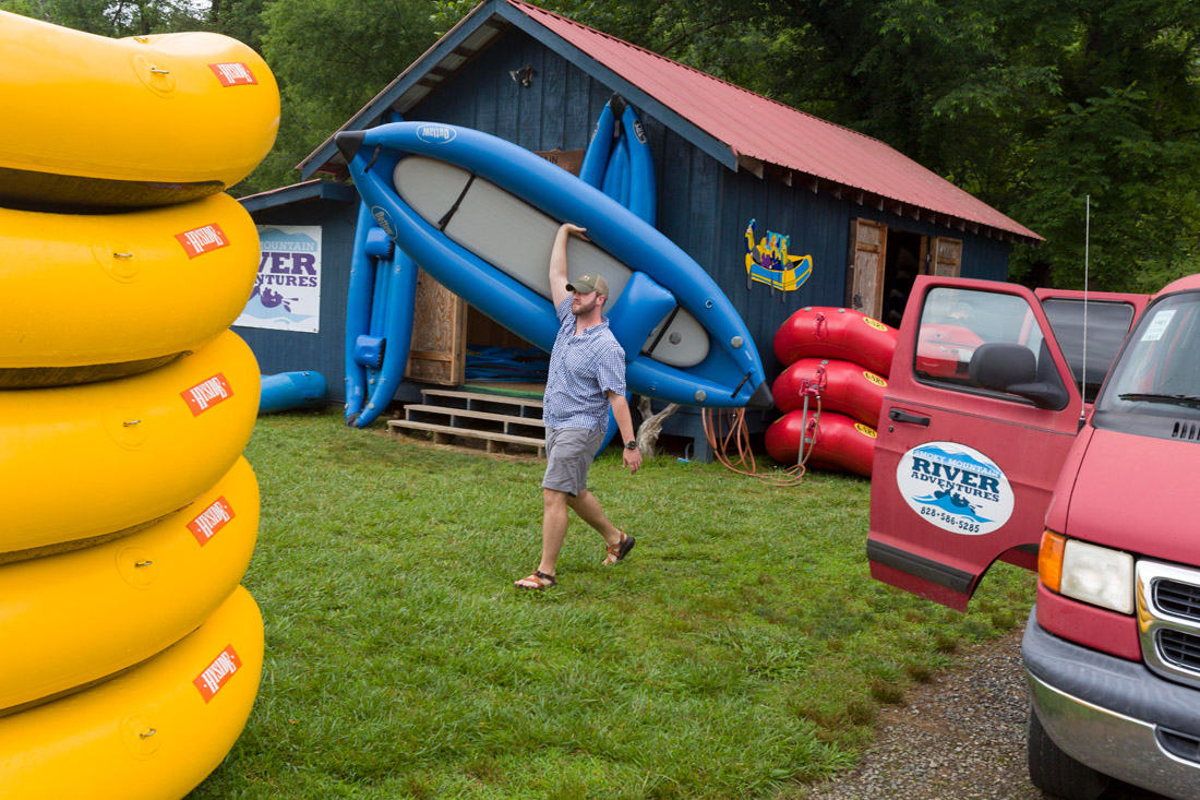 Dustin Williams, with Smoky Mountain River Adventures, carries an inflatable kayak at the popular whitewater rafting and kayaking company in Whittier, N.C. The outfit offers a variety of rafting trips for beginning and intermediate paddlers on the Tuckaseegee River.