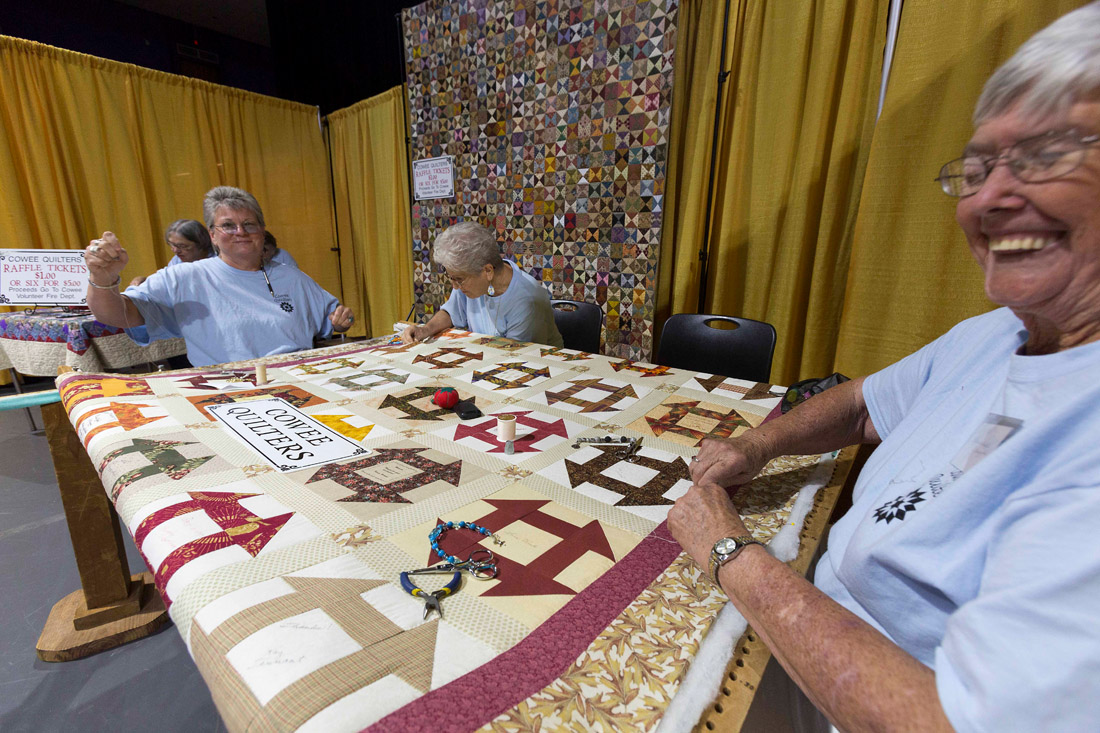 The Cowee Quilters of Franklin, N.C., from left, Cathy Bisdiof, Gail Osborne and Frankabelle Scuggs, share their love of quilting and socializing at the Mountain Artisans Fine Art & Craft Show at Western Carolina University's Ramsey Center in Cullowhee, N.C..
