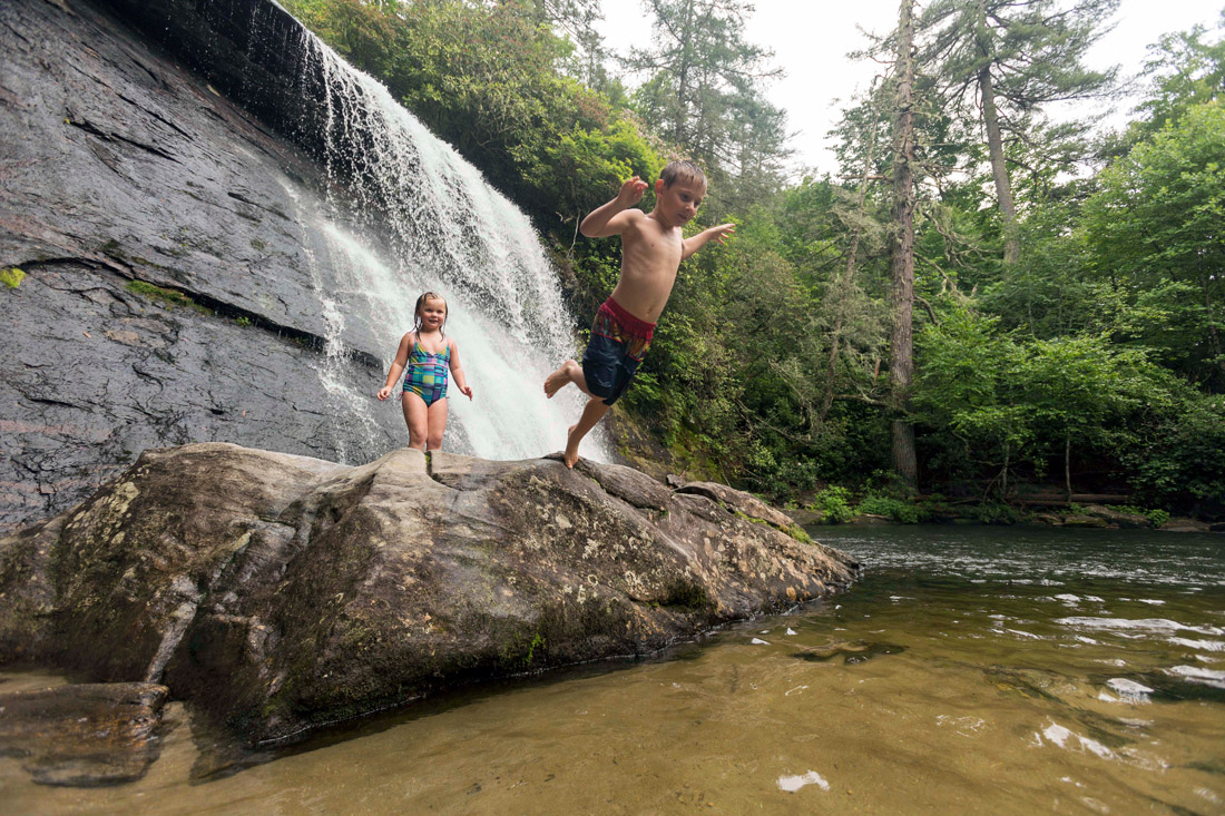 Siblings Trey and Leah Francisco (ages 6 and 4) of Walhalla, S.C., play in a swimming hole at Silver Run Falls, just south of Cashiers.