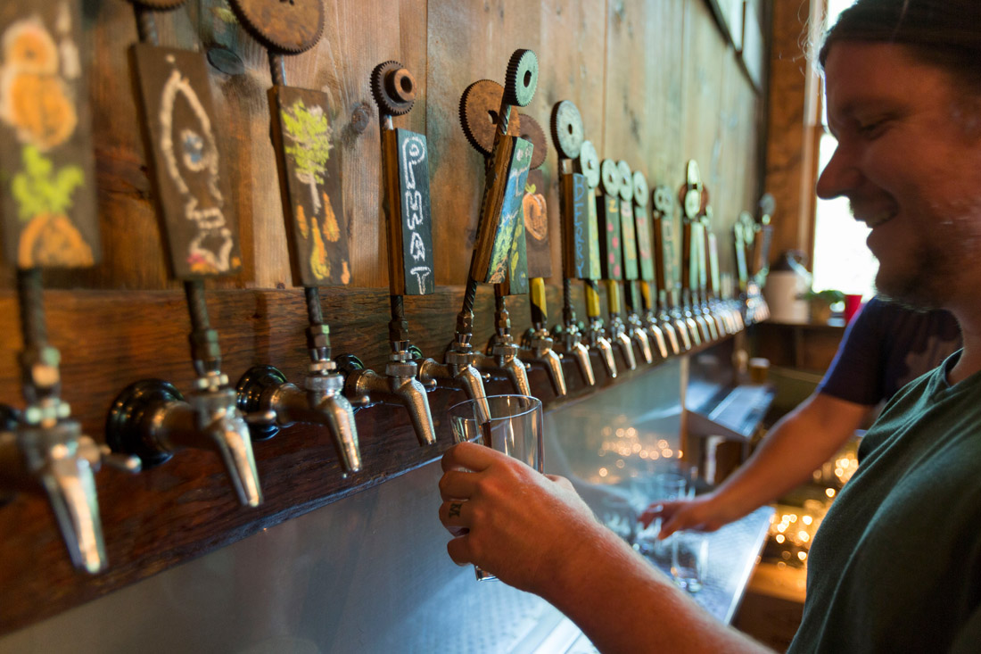 Bartender Kevin Morden pours a pint at Innovation Brewing, a local hangout in downtown Sylva known for its 30-plus hand-crafted ales, live weekend music and on-premises food truck.