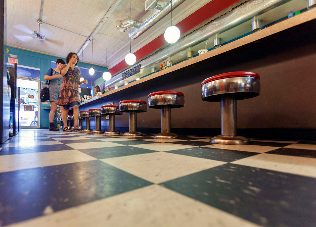 The checkered floor and antique bar stools of a bygone era are part of the charm that brings patrons to Guadalupe Café in downtown Sylva. Formerly a drug store, this farm-to-table eatery serves Caribbean-inspired cuisine, wines from Spain and Latin America, and craft beers from across the nation and right down the street.