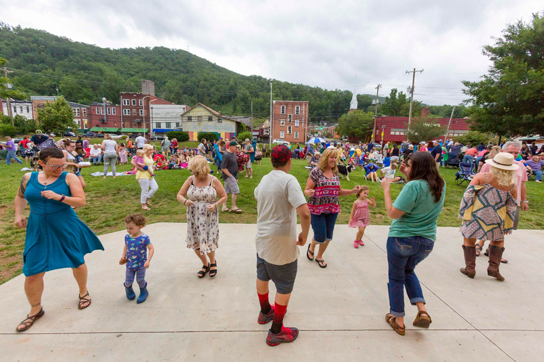 Friends and families gather to dance and enjoy live music at Concerts on the Creek, a free music series held every Friday night, Memorial Day through Labor Day, at Bridge Park in Sylva.