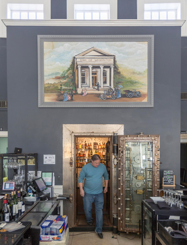 Roger Meyland, co-owner of The Bank Bistro & Bar, keeps the liquor and wine selections in the bank's old vault.
