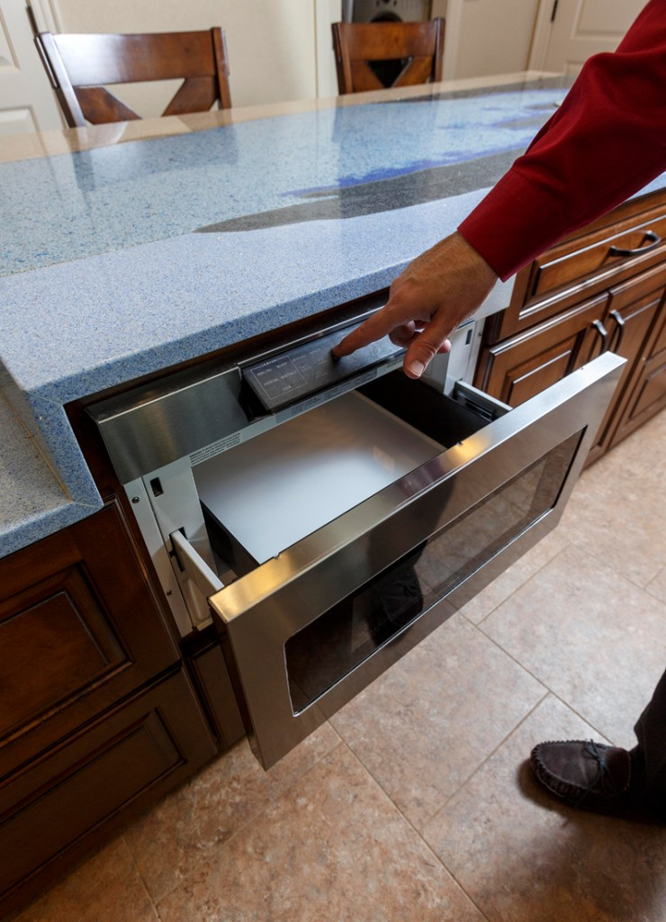 An accessible drawer-style microwave is built into the kitchen island.