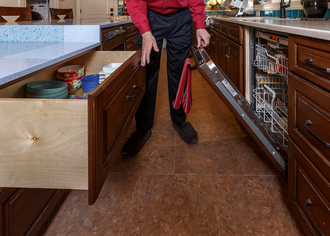 "John Toebes notes that tri-level kitchen cabinets allow storage flexibility. ""Right now we store things we rarely use in the high cabinets, everyday items in the middle range and less frequently used in the low,"" he said. ""But it can all be flipped as needed."""