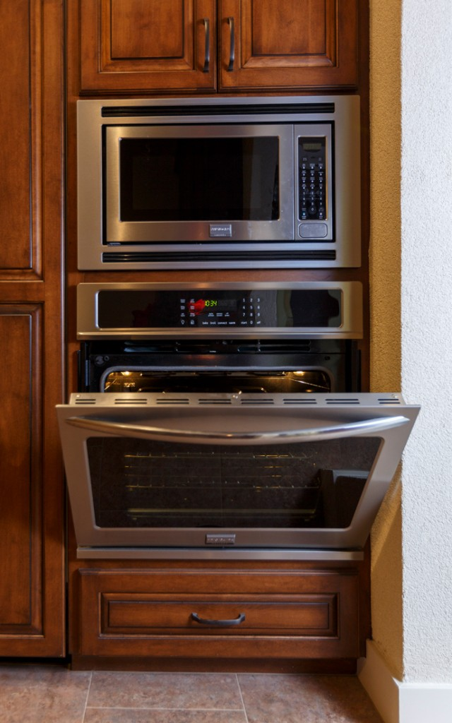 Wall ovens are strategically placed in this universal design.