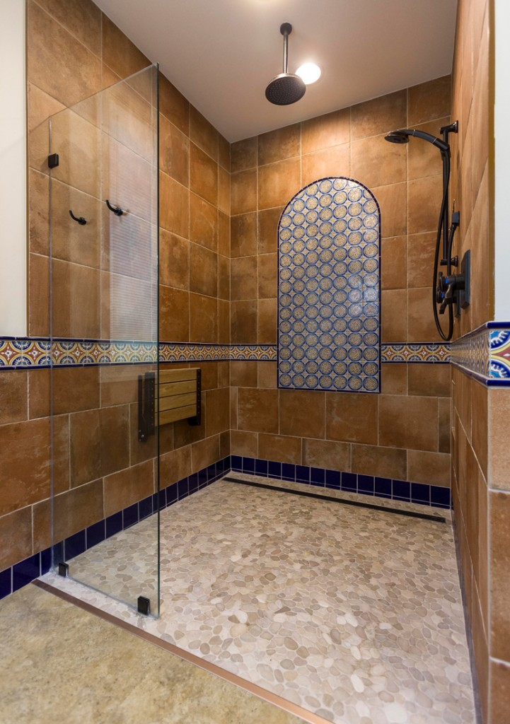Accessibility is key in the home's bathrooms, which feature pocket doors in the two-level vanities to permit wheelchair maneuverability, and tilting mirrors. In the shower, a drop-down bench, dual water controls and a handheld option address future needs.