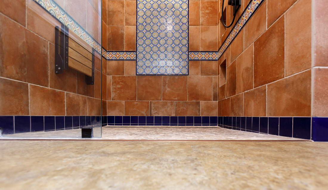 The luxury vinyl tile is used throughout the house, with flooring transitions in only two places: from LVT to tile in the walk-in shower and from LVT to carpet in the theater room.