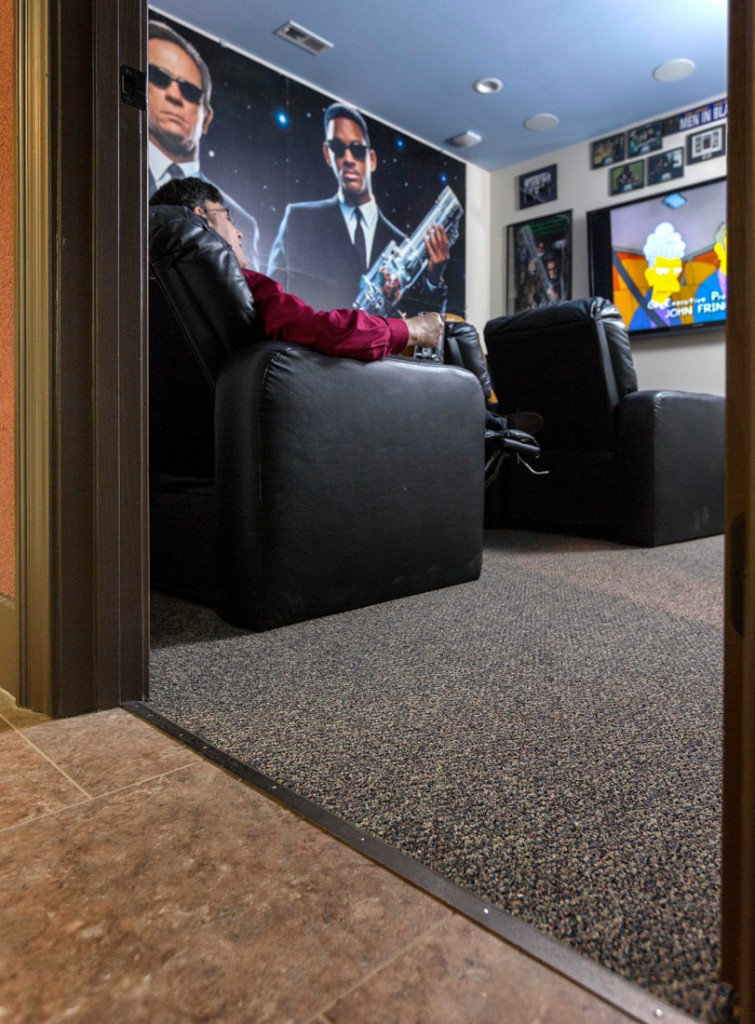 "An avid innovator, John Toebes served as producer for the ""Men in Black"" game on PC, and his MIB-themed theater room features original and signed memorabilia. Subtle or hidden technology is a priority in the soundproofed home, including 57 Ethernet drops, eight cameras and a central control room to manage it all."