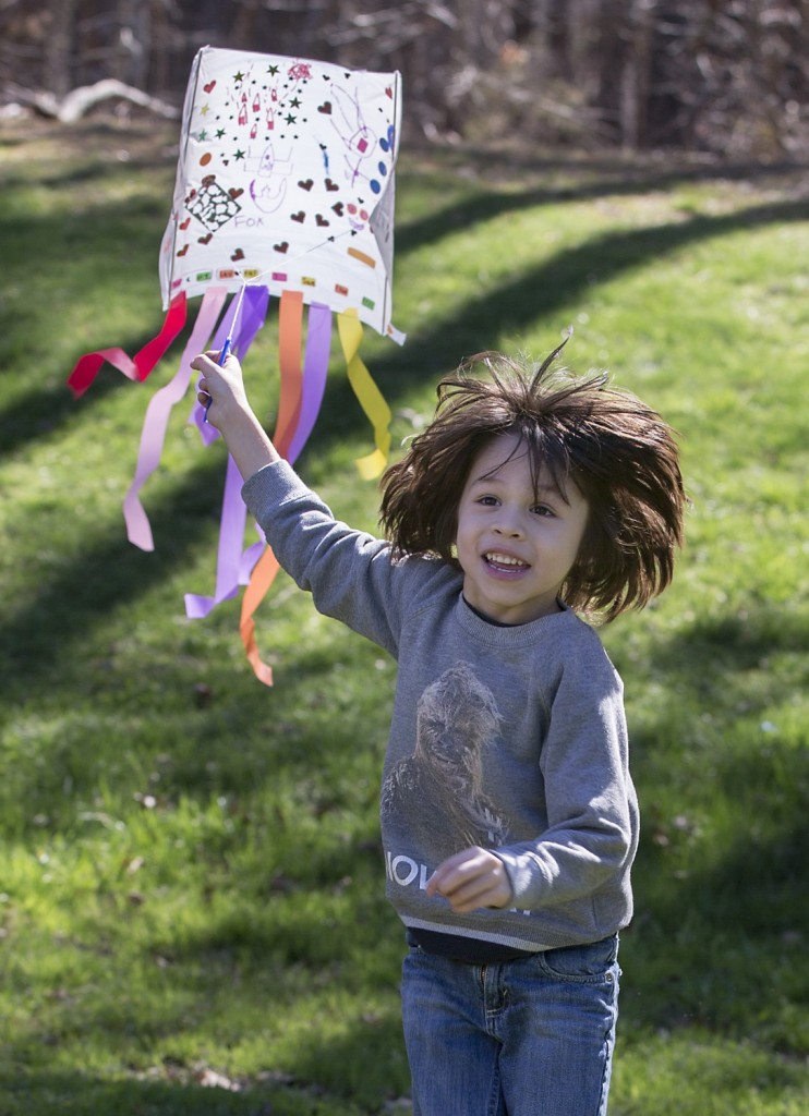 Four-year-old Daniel Beso of Cary test flies the kite he made