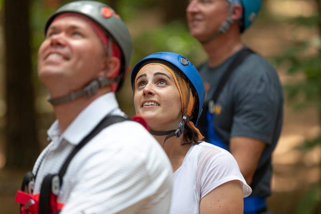 Google Fiber employee, Lea Sheridan, watches a coworker navigate the ropes course at Bond Park.